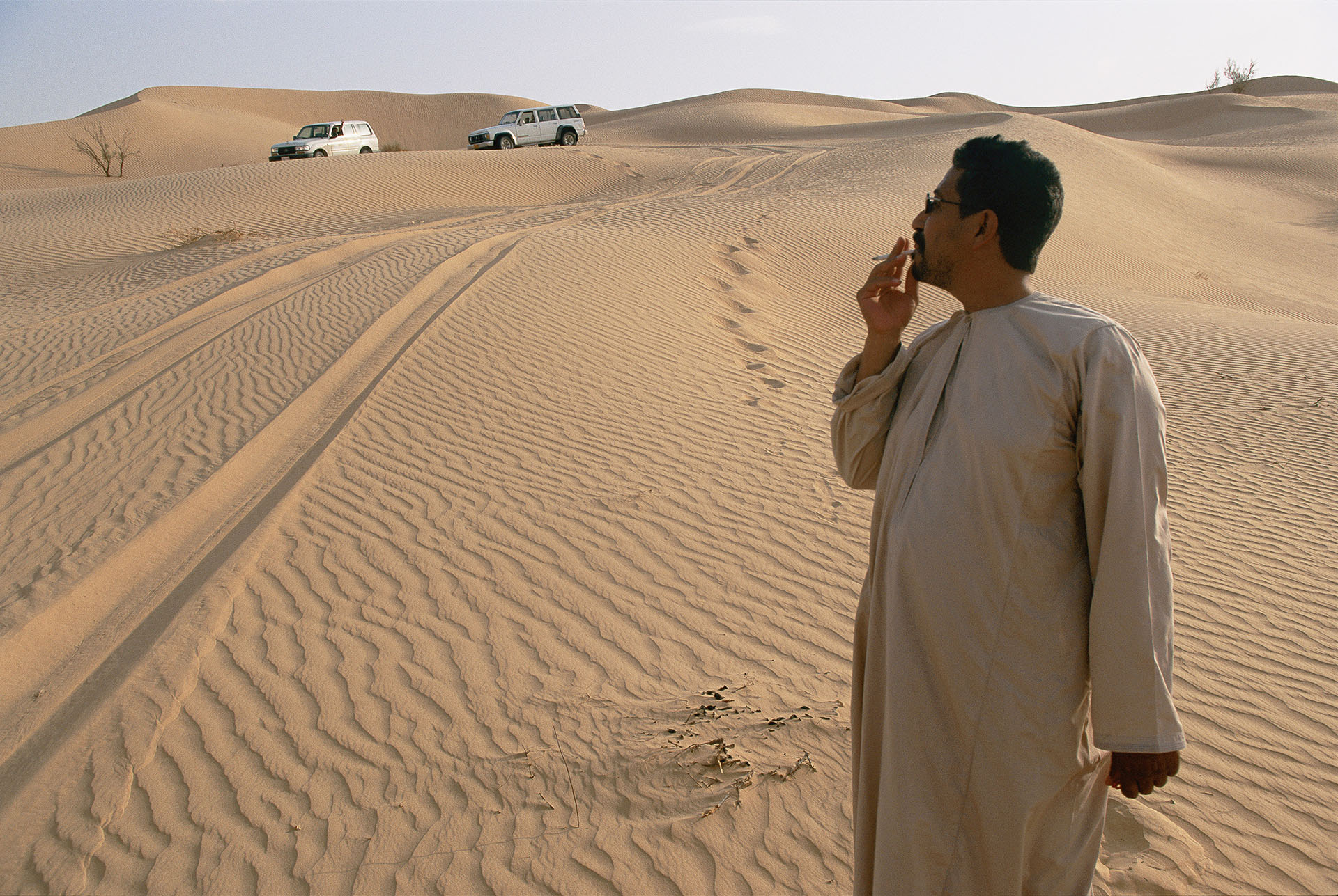 A Bedouin guide stands at the edge of the empty quarter.